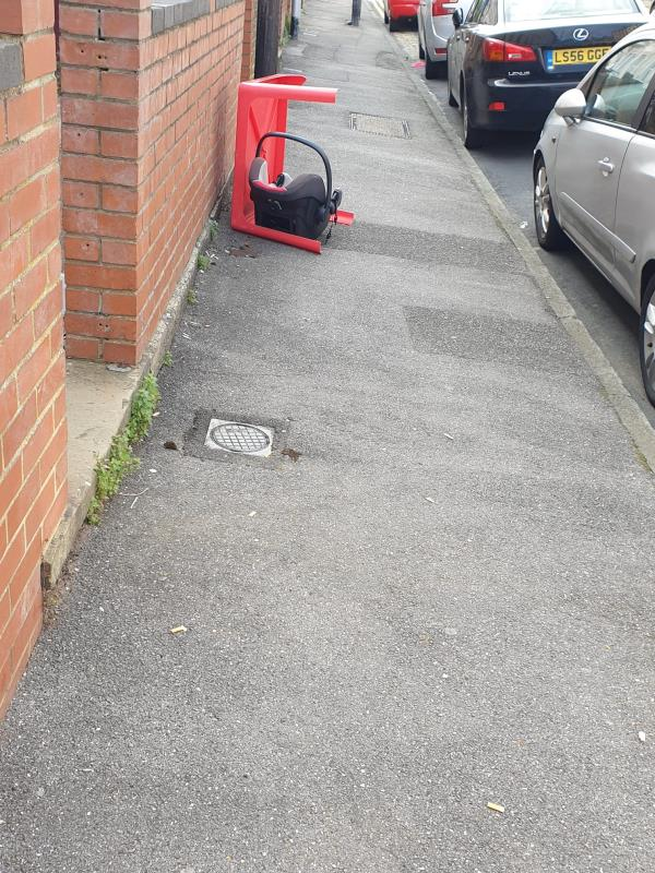 A broken table and child car seat has been put on footpath. This has been lying for over 2 weeks now.-18a Waylen Street, Reading, RG1 7UP