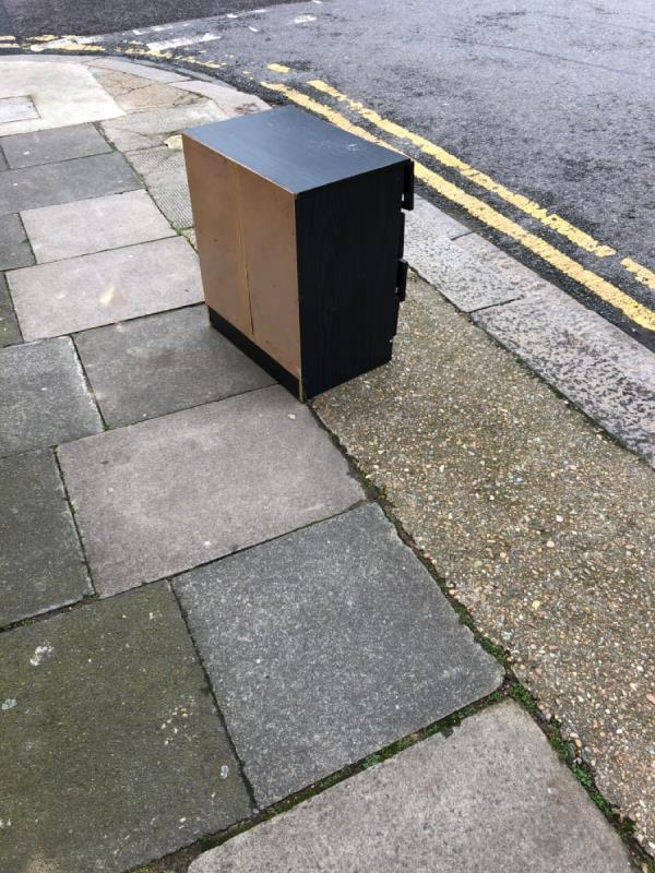 Black chest of drawers on the corner of samson/nile-10 Samson Street, London, E13 9EJ