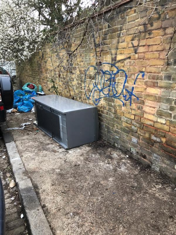 Fridge freezer and garden waste - soil, rubble -The Granary Comet Place, London, SE8 4AA