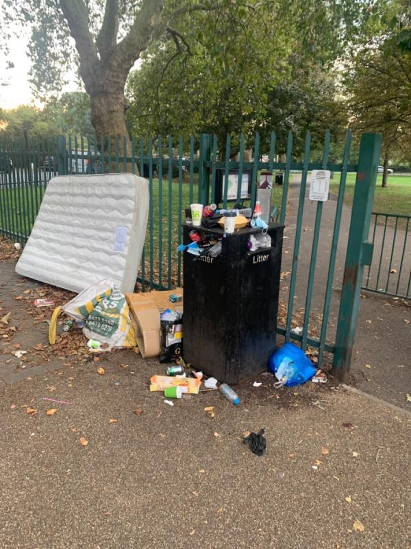 Mattress and other crap dumped by entrance to park opposite 369 burges road e6. Bin overflowing with rubbish thrown all around. Bin absolutely heaving and covered in flies. I nearly puked.-373 Burges Road, East Ham, E6 2PB