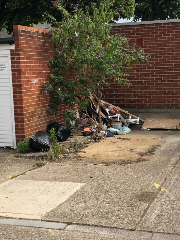 Rubbish dumped next to garages on Amity Road-16 Amity Road, Reading, RG1 3LJ