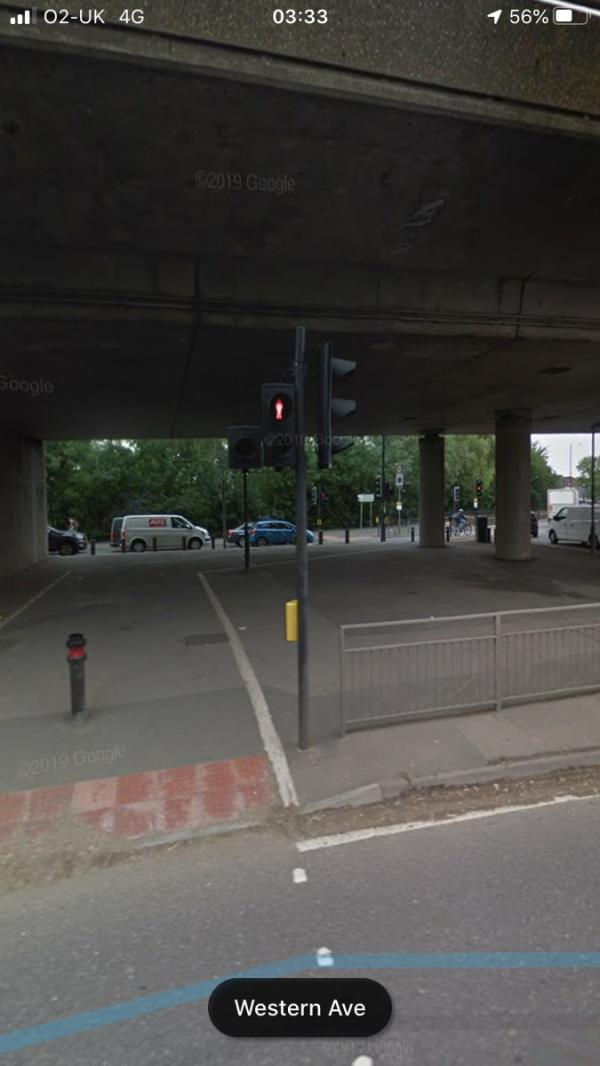 Black Ealing Council Lamp column is not working on a public footpath under the overpass linking two pelican crossings on Greenford Roundabout- column has no number-6 Western Avenue, London, UB6 9JS