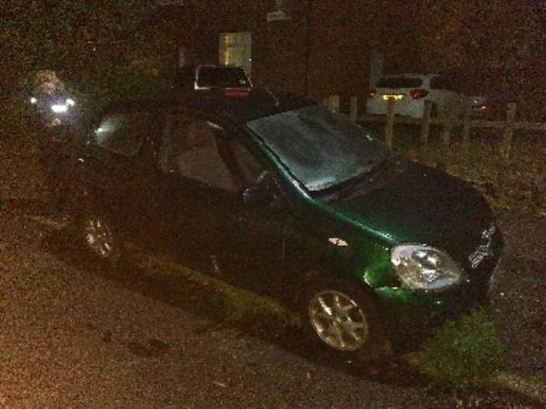 This vehicle appears to have been abandoned. It has two flat tyres and a smashed front drivers window. It is attracting ASB from youths and I cannot find the VIN number to see if it is on false plates.-2 Iliffe Rd, Leicester LE4 9DG, UK