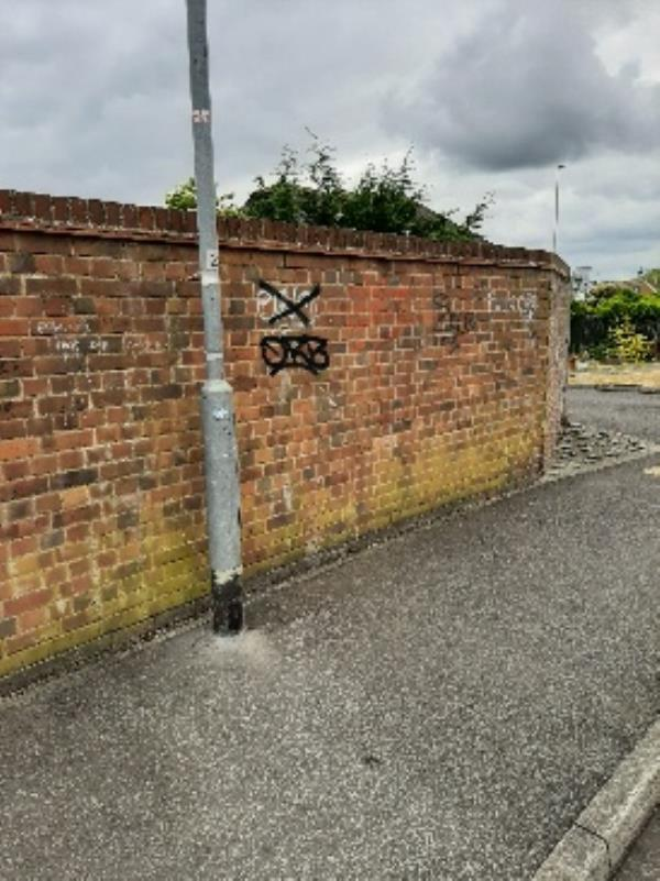 vicinity of lamp column 2 in Kingsmere just by Pevensey Bay Rd- graffiti by spray paint onto brick wall, some obscene words to be removed. please pass to seesl-20 Edmund Cl, Eastbourne BN23 6TX, UK