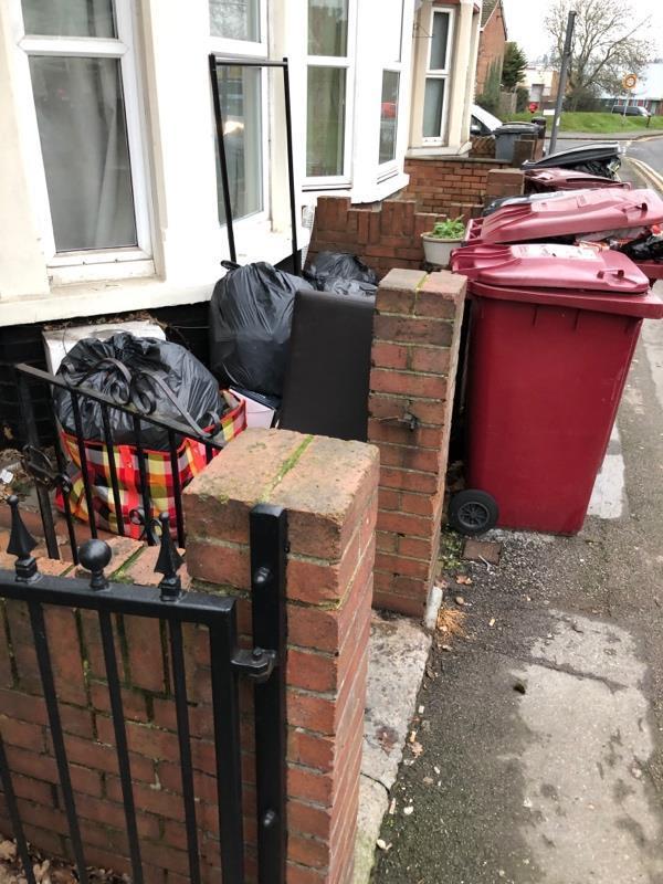 Bins unemptied, rubbish piled in garden .  Rats seen running around -61 Beresford Road, Reading, RG30 1BU