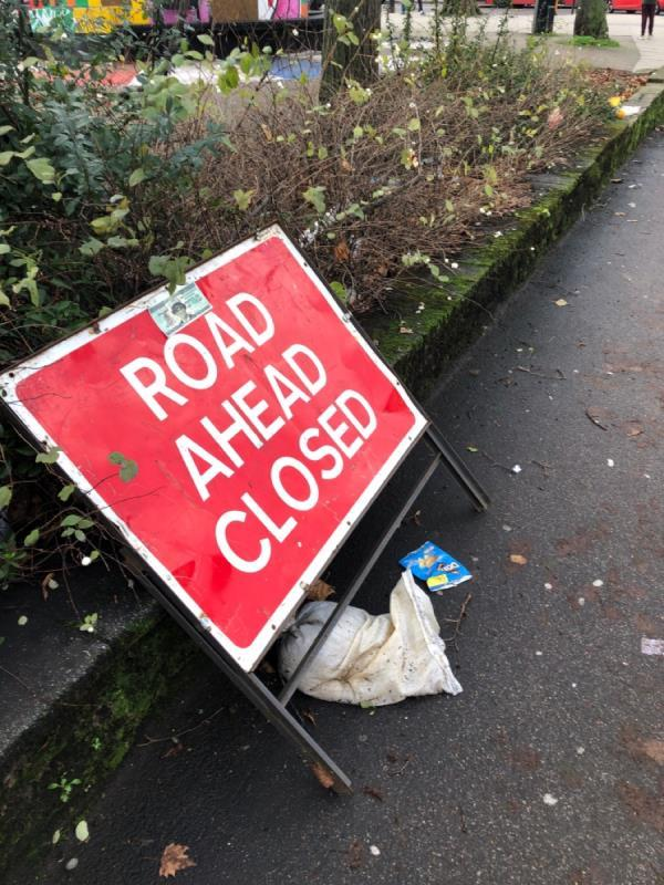 Discarded road signs and in the bushes - Page Green Common jct High Road-261c High Road, London, N15 5BT