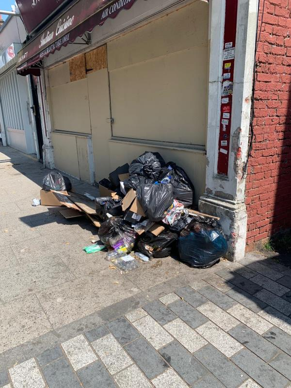 fly tipping - apparently you cleared this earlier today, but honestly it looks like the same rubbish to me...-61a Dartmouth Road