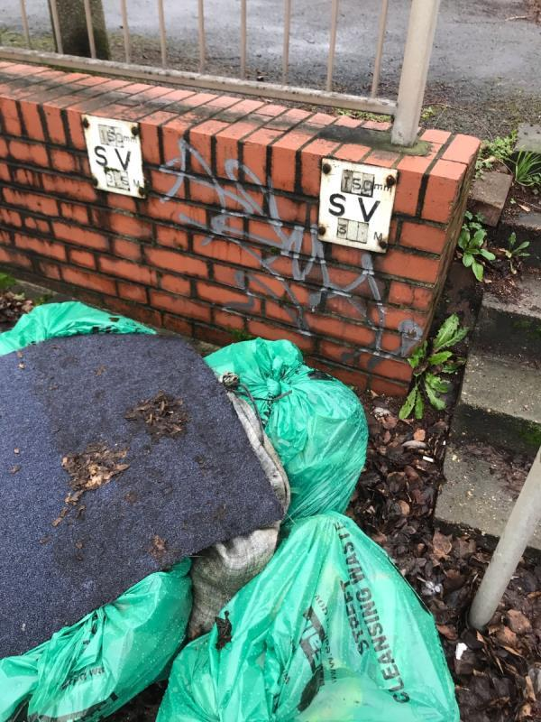 Silver spray painted tag is located on a brick wall on A40 Western Avenue junction Ribchester Avenue ub6-2 Ribchester Avenue, London, UB6 8TQ