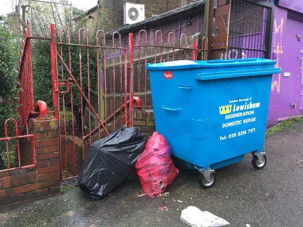 Dumped commercial food waste on pavement and foul chicken pieces. Blocking fire exit and muster point and pedestrian entrance and exit gate. -3 Clyde Vale, London, SE23 3JG