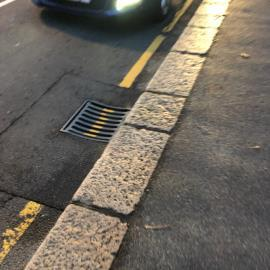 Please fix this loose road gulley. First reported 6months ago. Nothing done. Sounds like thunder in my house every time a bus drives over it !-Tower Gardens Apartments, Le Mont Cochon, St. Helier, Jersey, JE2 4ZY