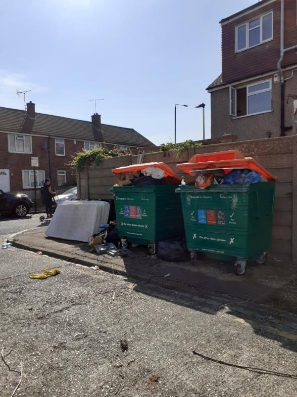 fly tipped items by recycling bins and bins overflowing-12 Globe Road, London, E15 1RF