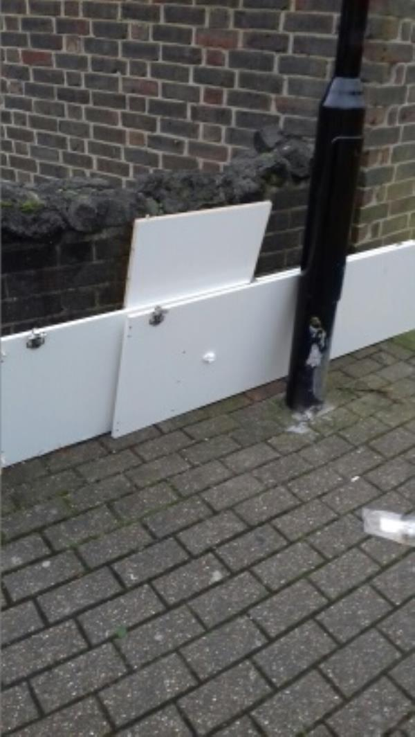 Dismantled cupboard dumped at Palmer Road junction near block 160 to 170 Prince Regent Lane -158 Prince Regent Lane, London, E13 8SG