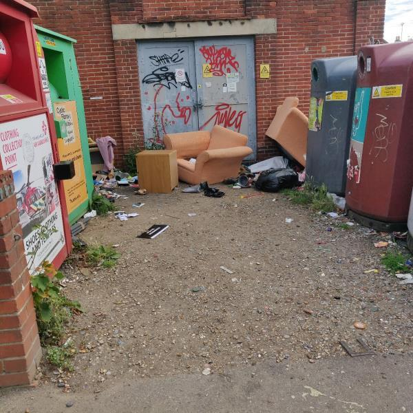 Armchairs dumped amongst other stuff at recycling area-2 Huntley Court Erleigh Road, Reading, RG1 5NW