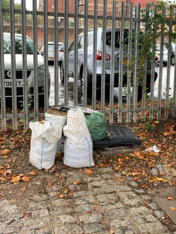 Flytipped rubbish by the car park of Newtown Primary School-336 Kennet Side, Reading RG1 3EA, UK