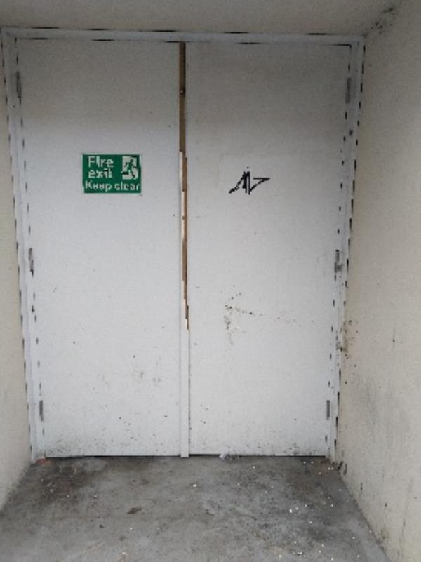 tagged on fire exit door next to Bradgate Lace-17a Cank Street, Leicester, LE1 5GX