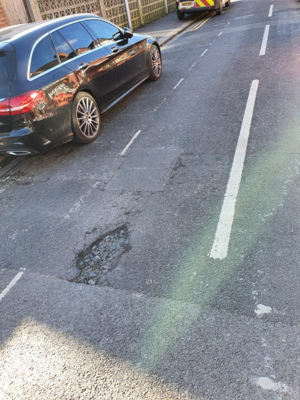 Pothole opposite 106 Curzon st.-108 Curzon Street, Reading, RG30 1DA