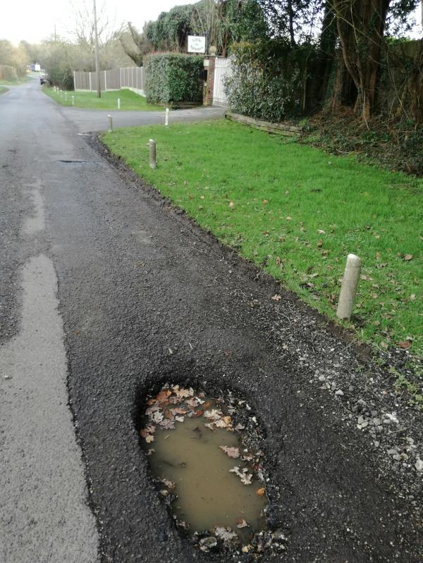 Dangerous pothole that punchered my car tyre and may have damaged the rim. image 2-Blackmill Spinney Blackmill Lane, Chichester, PO18 0JU