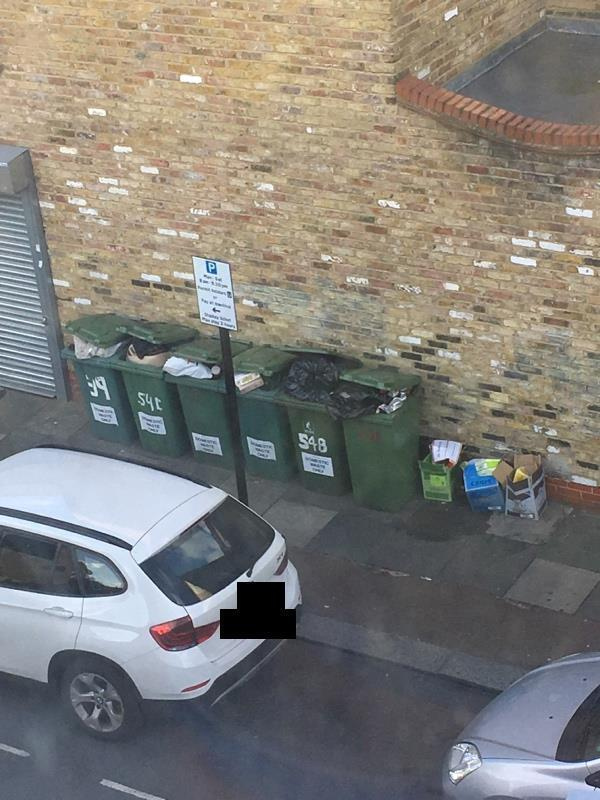 Box's beside bins from a shop  Leaving these bins overflowing causes fly tipping as there used by shops in Plashet Grove????-36 Plashet Grove, London, E6 1AE