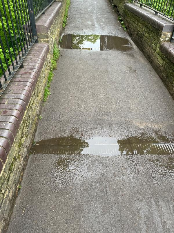 Unblock two drain gully's on footbridge to park -35 Oxford Road, Finsbury Park, N4 3EY