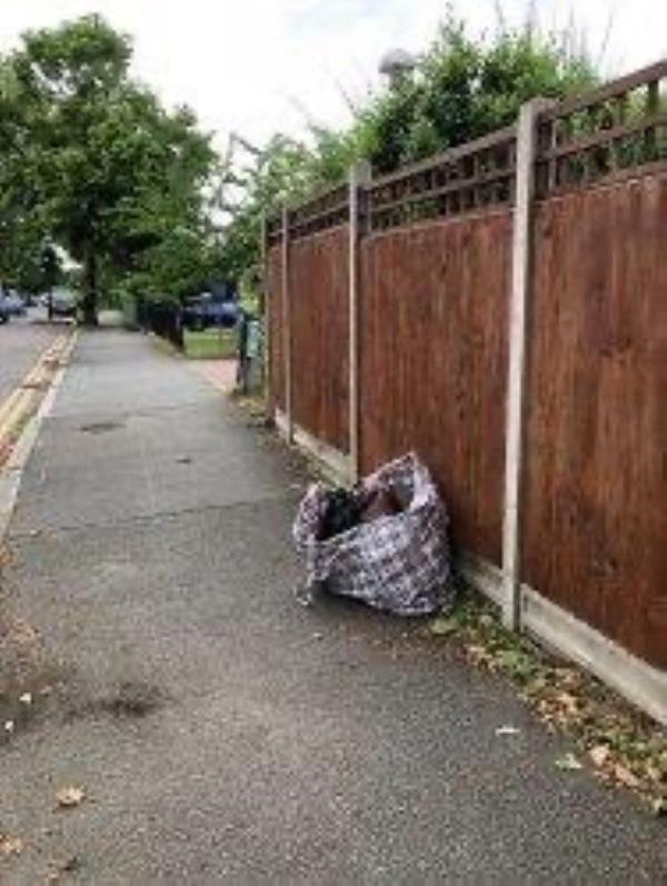 Please clear flytip of a bag-90 Somertrees Avenue, London, SE12 0BY