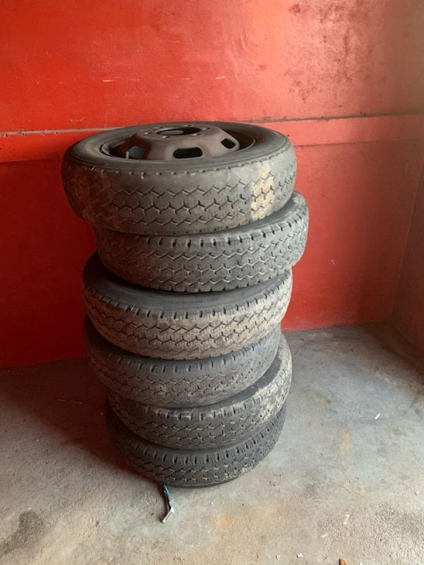 These tyres have been underneath the shutter at falcon street car park for 2 weeks now need taking out and collected please -68 Falcon Street, London, E13 8DE