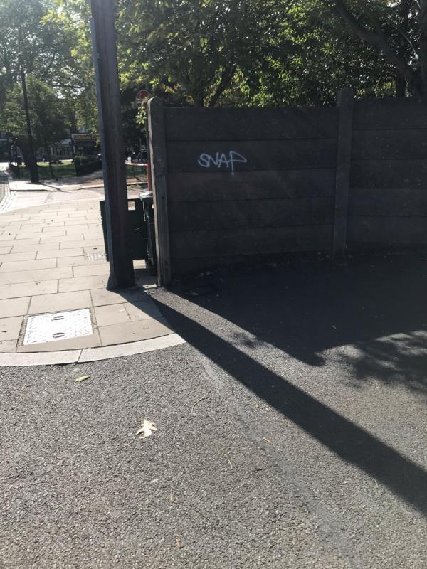 Spray painted tags are located on a concrete wall situated next to Greenford police station Ub6 -21 Oldfield Lane South, Greenford, UB6 9QN