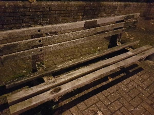 Damaged bench (not litter bin but there is no bench category).  Missing beam of wood from seat of bench on the corner of Lime Street and Queens Road.-68 Queens Road, Aldershot, GU11 3JD
