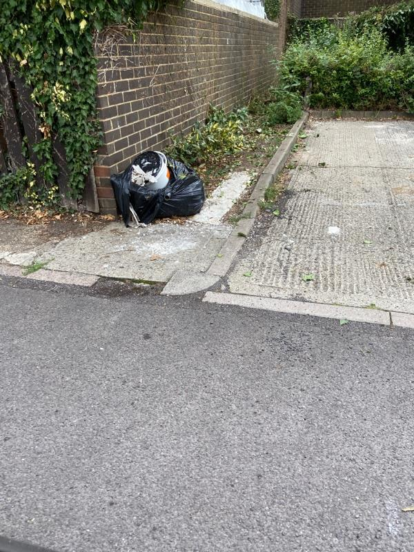 Rubbish left by the public car park -35 Chaucer Road, Farnborough, GU14 8SP