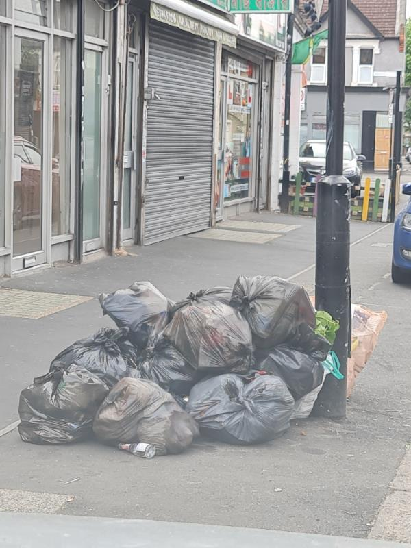 Black bags approximately 10 don't they have bins on this street?-80 Katherine Road, East Ham, E6 1EN