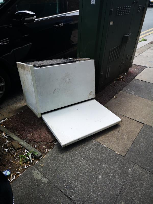 By telephone green boxes... Fridge just been discarded. This is a hot spot for people to put there rubbish. -89 Inniskilling Road, Plaistow, E13 9LD
