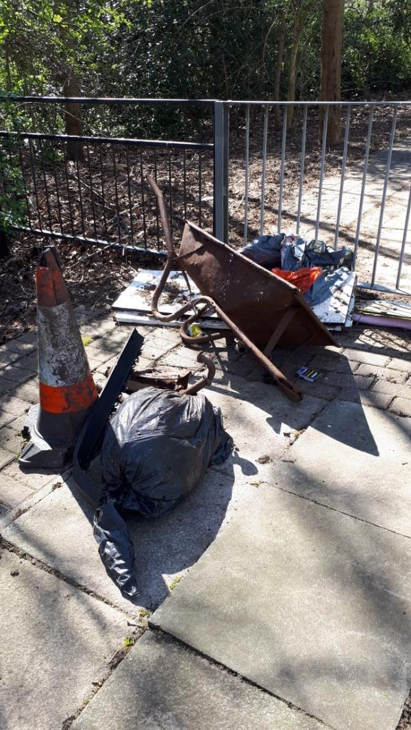 Flytipping in Jake Russell Walk E16 adjacent to property 63 Richard House Drive E16-63 Richard House Drive, London, E16 3RE