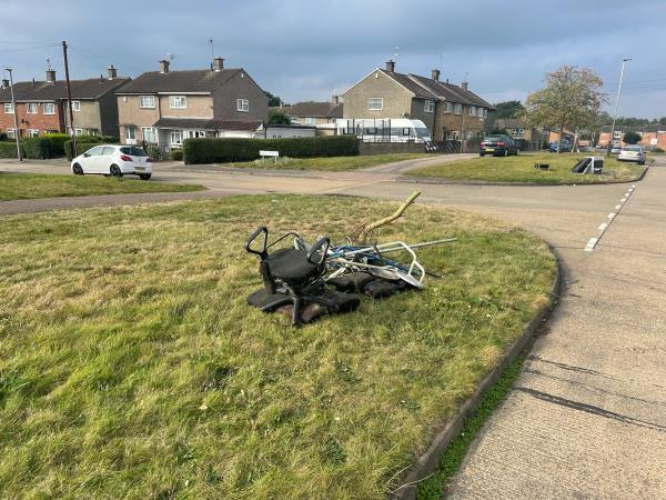Fly tipping - rubbish dumped at location on the grass-16 Monmouth Drive, Leicester, LE2 9RJ