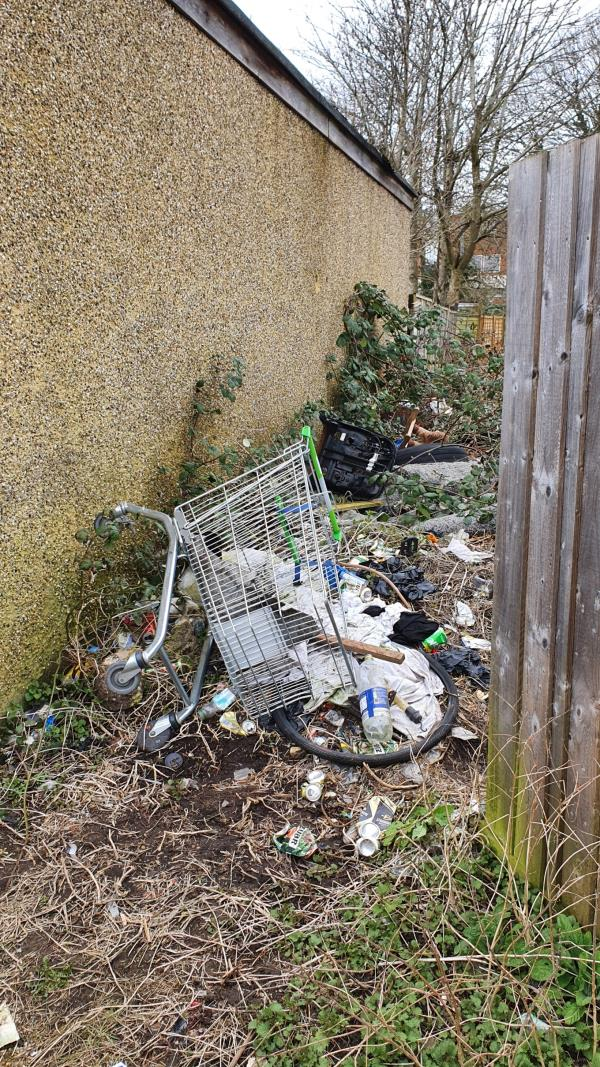 A huge amount of various litter. Now including a shopping trolley and car seat.  Not sure if this is being dumped by the car garage that operates in the house that backs onto this location, but it's always full of junk-17 Beatty Drive, Reading, RG30 6NE