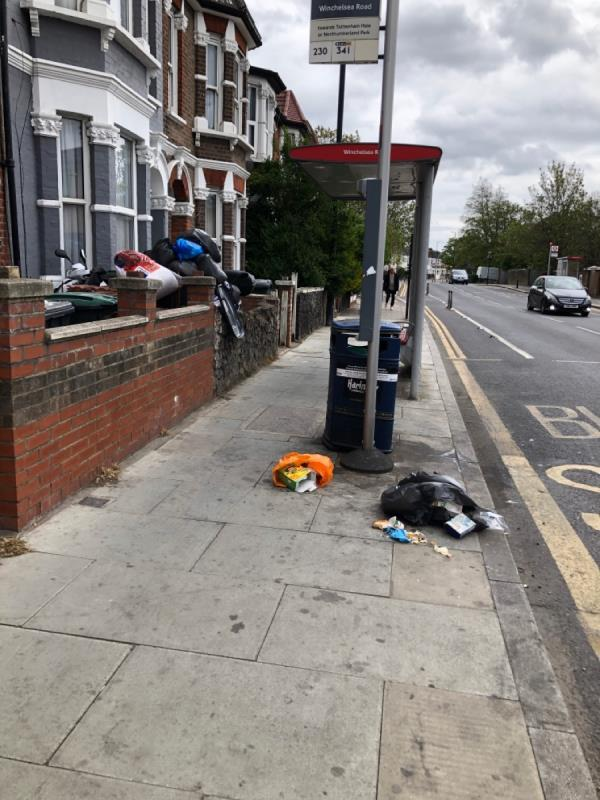 Rubbish spewing out of full bins and onto pavement -102 Philip Lane, Seven Sisters, N15 4JL