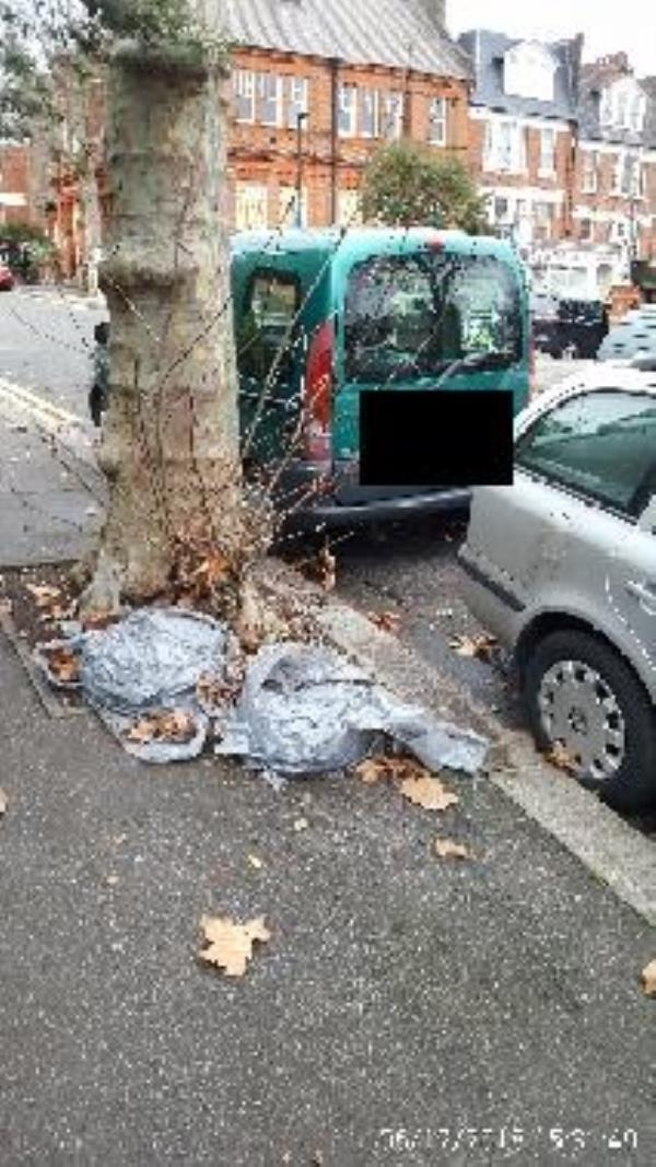 2 dumped grey bags of soil on Stapleton Hall Rd near Quernmore Rd junction-38 Quernmore Road, London, N4 4