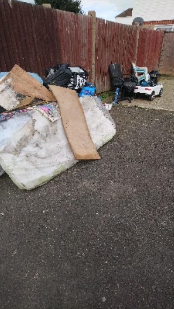 Fly tip in car park area of Barrington house heroes walk -18 Heroes Walk, Reading, RG2 8TY