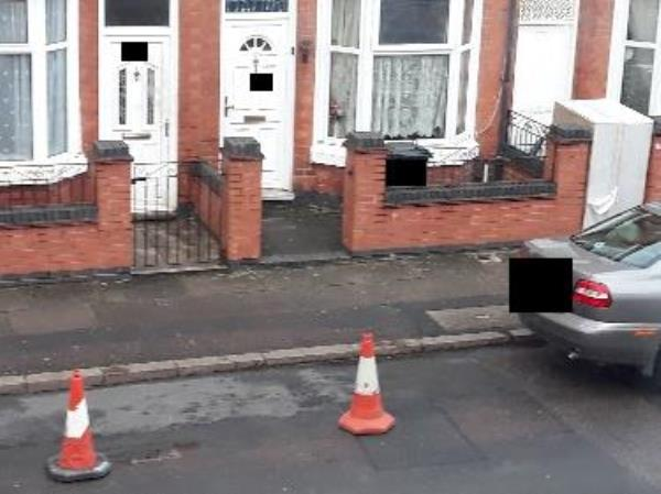 Road obstruction using cones for parking. This is now a routine occurrence. They also have an abandoned bed near the back door-72 Lancashire Street, Leicester, LE4 7AE