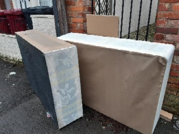 a large bed base and other rubbish has been dumped on walkway next to church on valentia road. -41 Valentia Road, Reading, RG30 1DH