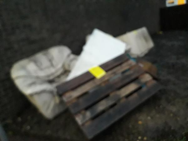 sofa, 2x single chairs. pallet, multiple bags of building waste,  wood and glass-37 Valetta Grove, Plaistow, E13 0JR