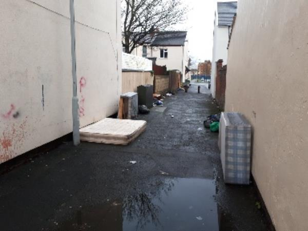 bed bases, mattresses and approximately 20.black bags of household waste dumped in the alleyway all saints rd and gower st. -101 All Saints Road, Wolverhampton, WV2 1EJ