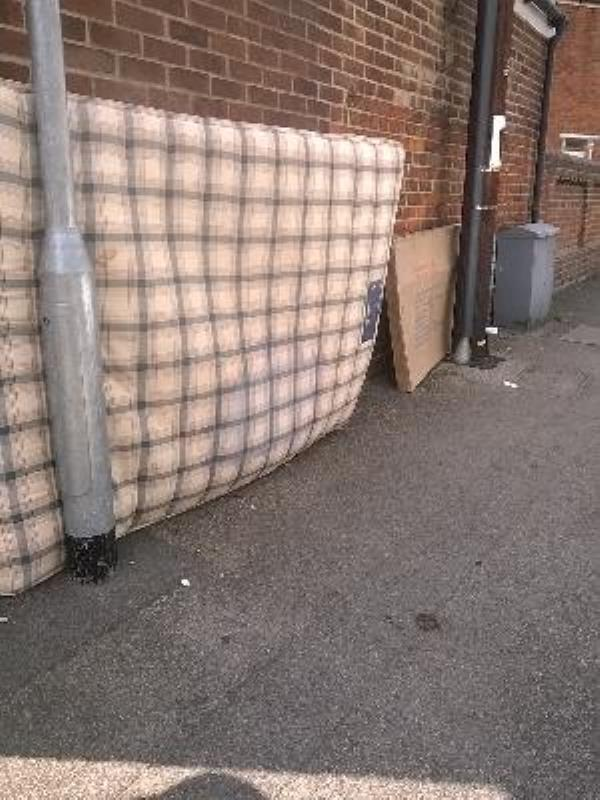 double mattress and cardboard on pavement-95 Radstock Road, Reading, RG1 3PR