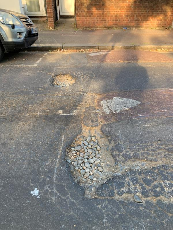 There are two big potholes near number 1 wood house grove. It's a very busy road and damage to car is very likely. Need to sort it out ASAP.-1 Woodhouse Grove, East Ham, E12 6SR