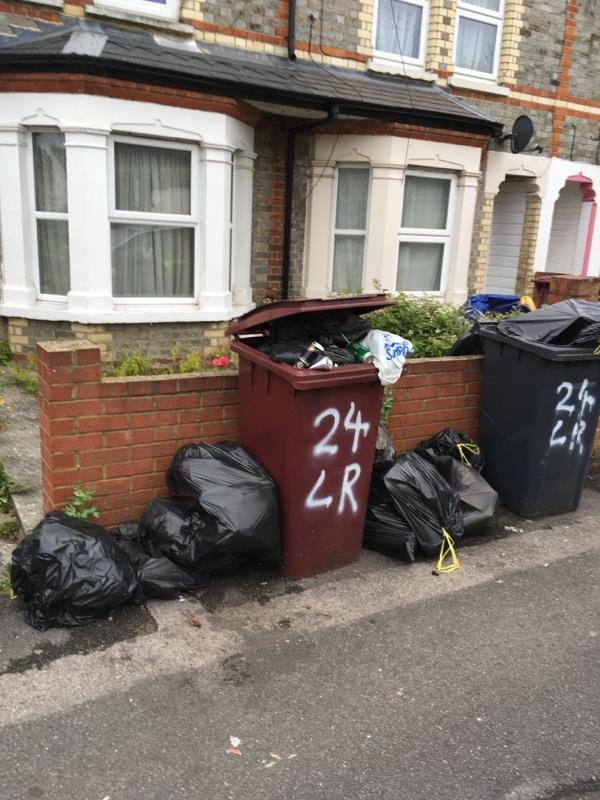 Unacceptable amount of rubbish dumped outside house.-102 Radstock Rd, Reading RG1 3PR, UK