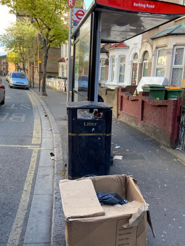 Various rubbish at bus stop R outside 8 Boundary road-1a Boundary Road, Plaistow, E13 9PS