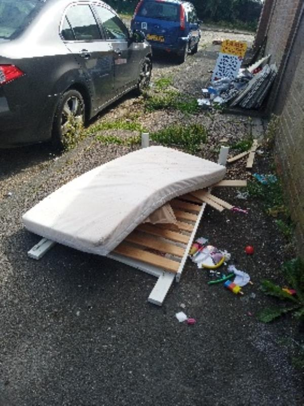 please remove fly tipping at block 42-48 Coronation square-45 Coronation Square, Reading, RG30 3QP