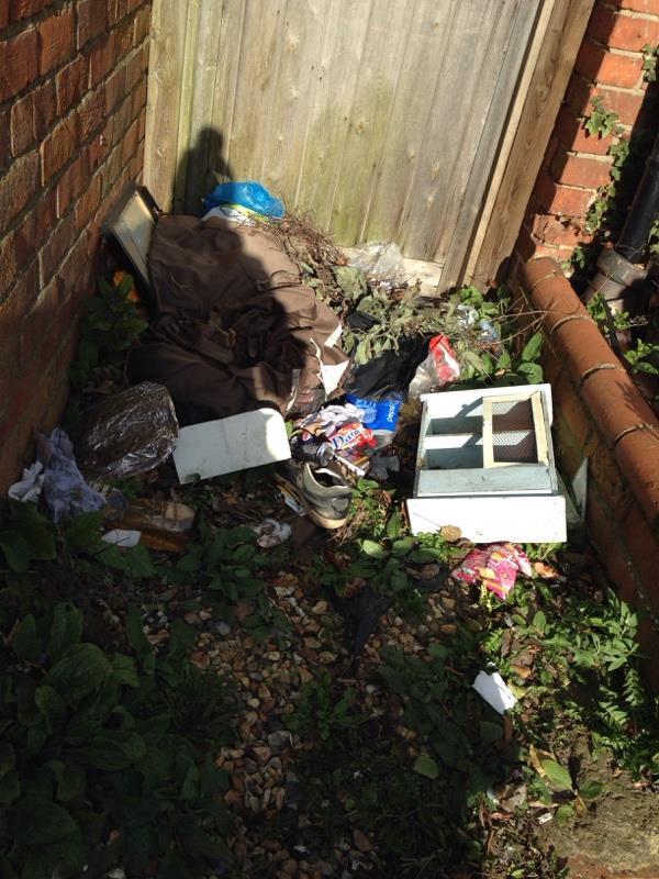 Dumped belongings next to footpath and garden-1 Wykeham Road, Reading, RG6 1NR