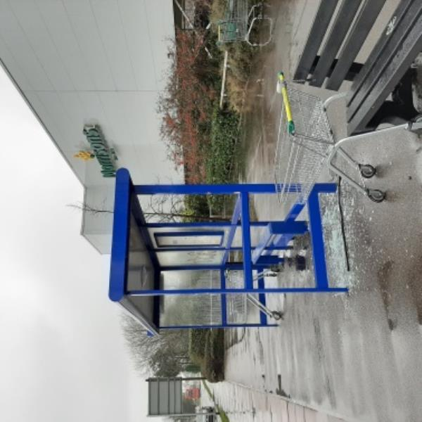 SEESL - 12/12/19. Glass pane broken at Morrison bus stop opposite B&Q. Please sweep asap.-Lottbridge Drove, Eastbourne, BN23 6QN