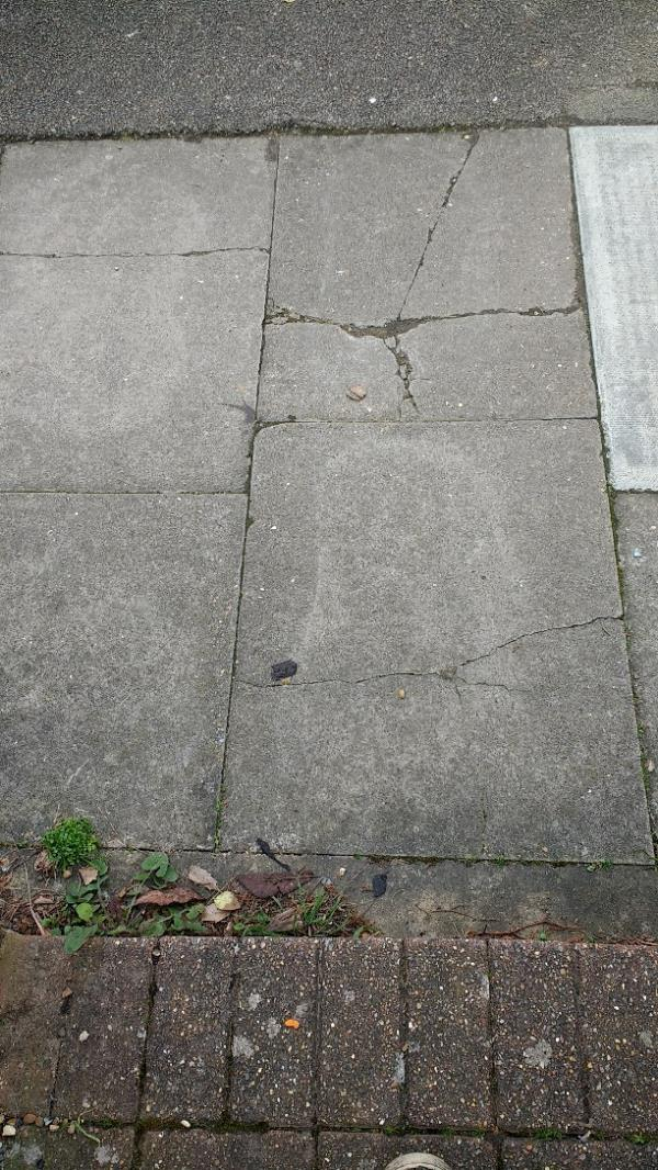 Cracked pavement slabs x 3-26 Milborough Crescent, London, SE12 0RN