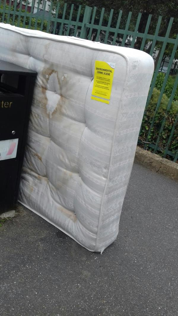 A mattress dumped near the litter bin opposite 150 Lonsdale Avenue -146 Lonsdale Avenue, East Ham, E6 3JX