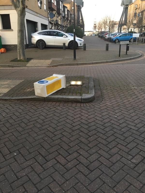 On traffic island junction of Wesley Avenue and Constable Avenue. Bollard knocked down -Caernarvon House, 8 Audley Drive, London, E16 1TD